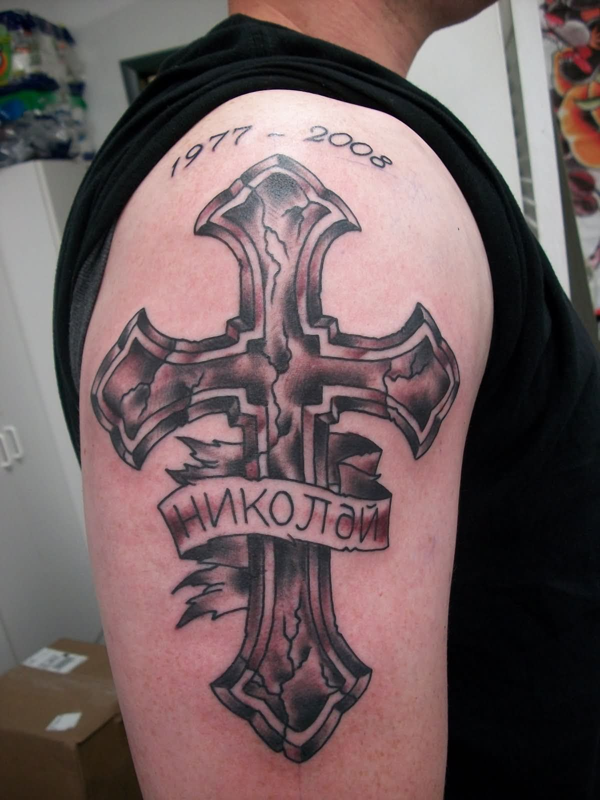 Memorial Cross With Banner Tattoo On Man Right Shoulder