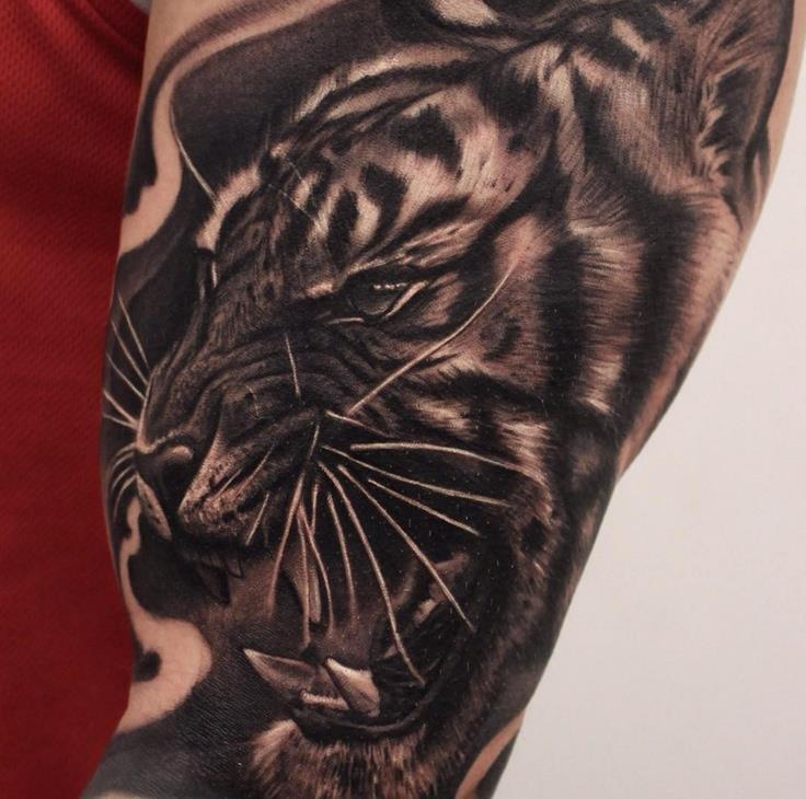 Black and grey tiger sleeve tattoo