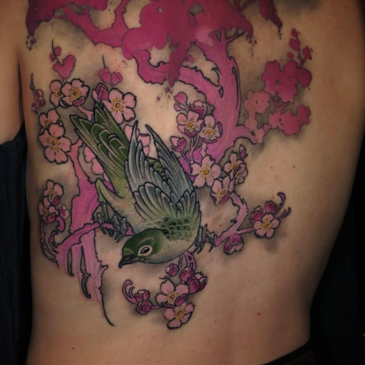 Bird on branch tattoo