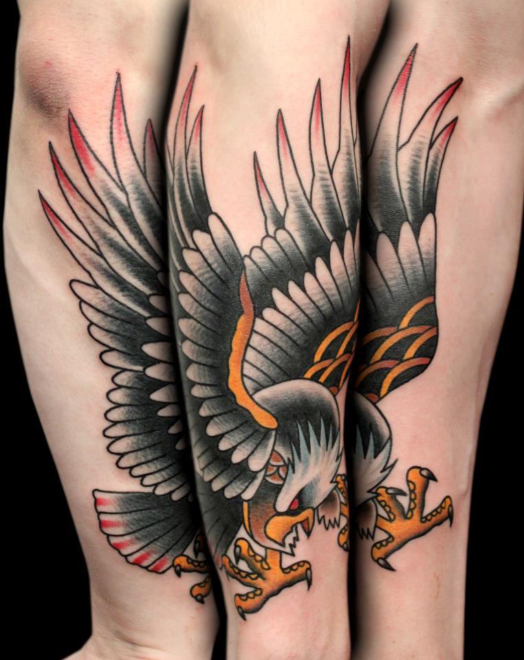 Traditional american eagle arm tattoo