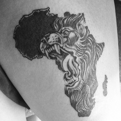 7b04a94497f9e Black ink roaring Lion's head in African map tattoo