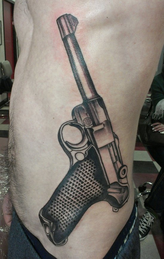 58 most amazing pistol tattoos designs. Black Bedroom Furniture Sets. Home Design Ideas