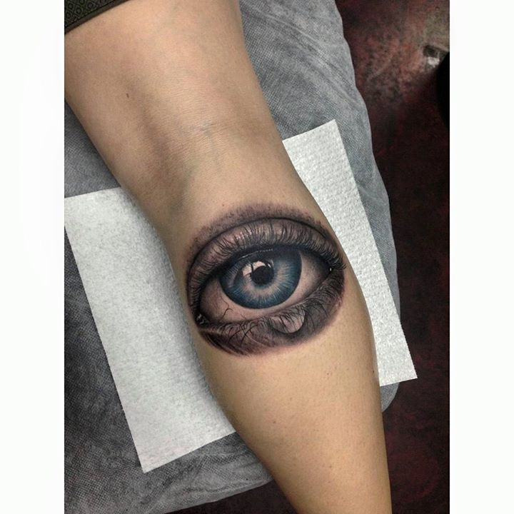 Awesome eye tattoo on leg by Whitney Develle