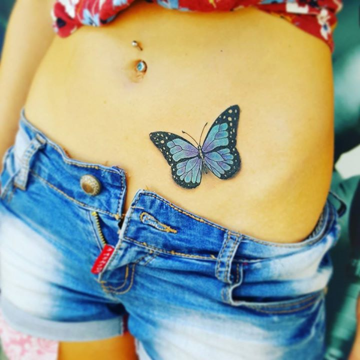 Butterfly tattoo on hip by David Torres