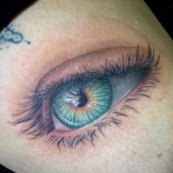 Green eye tattoo by Samm Lacey