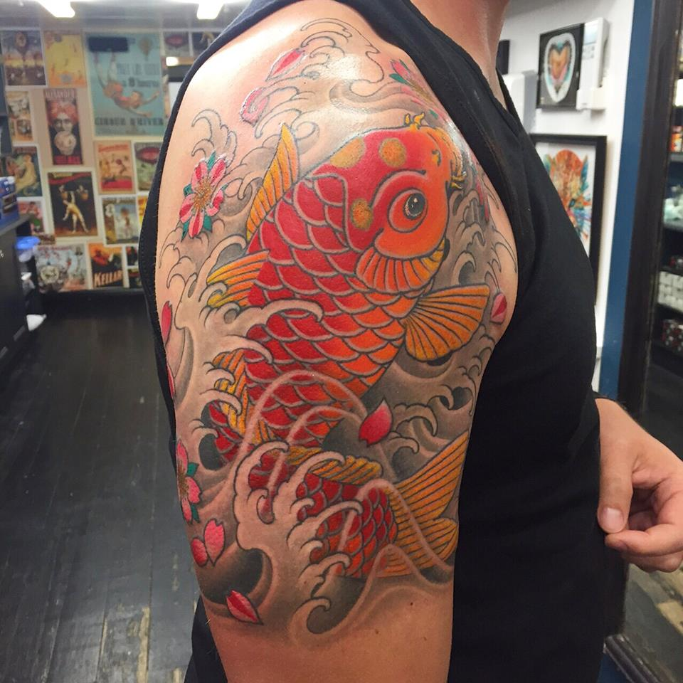 Colored Japanese Koi Tattoo On Half Sleeve