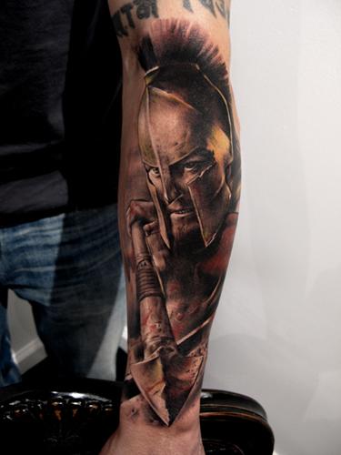 Realistic Grey Ink Movie 300 Tattoo On Left Sleeve