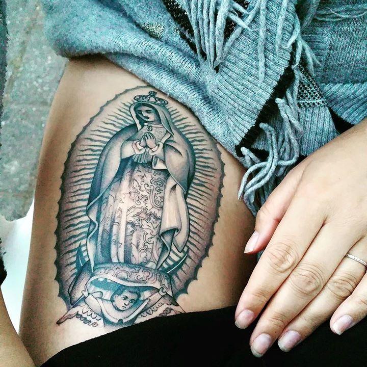 Saint Mary tattoo on siderib by Didson Scripts