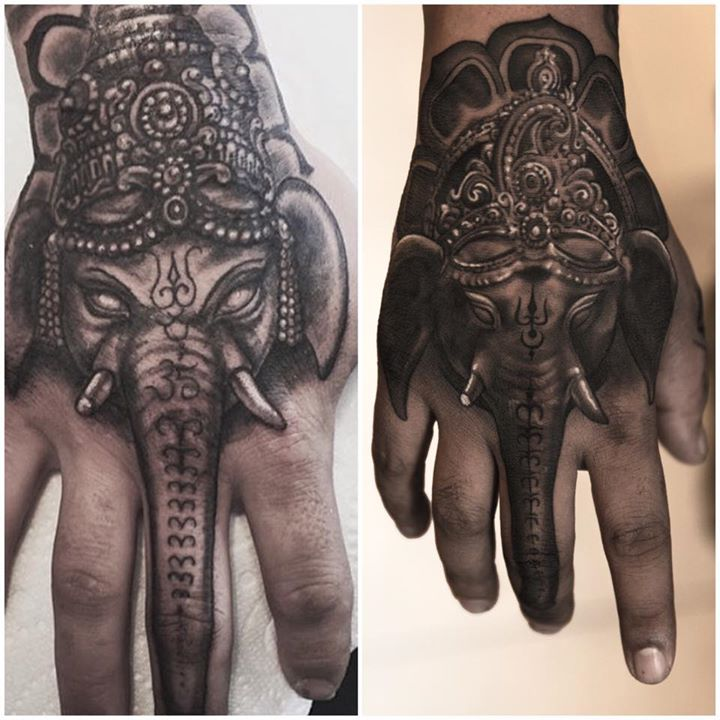 Spectacular Lord Ganesha Tattoo on Hand By Niki Norberg