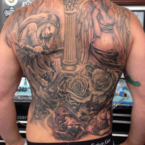 Warrior lady with roses tattoo on full back