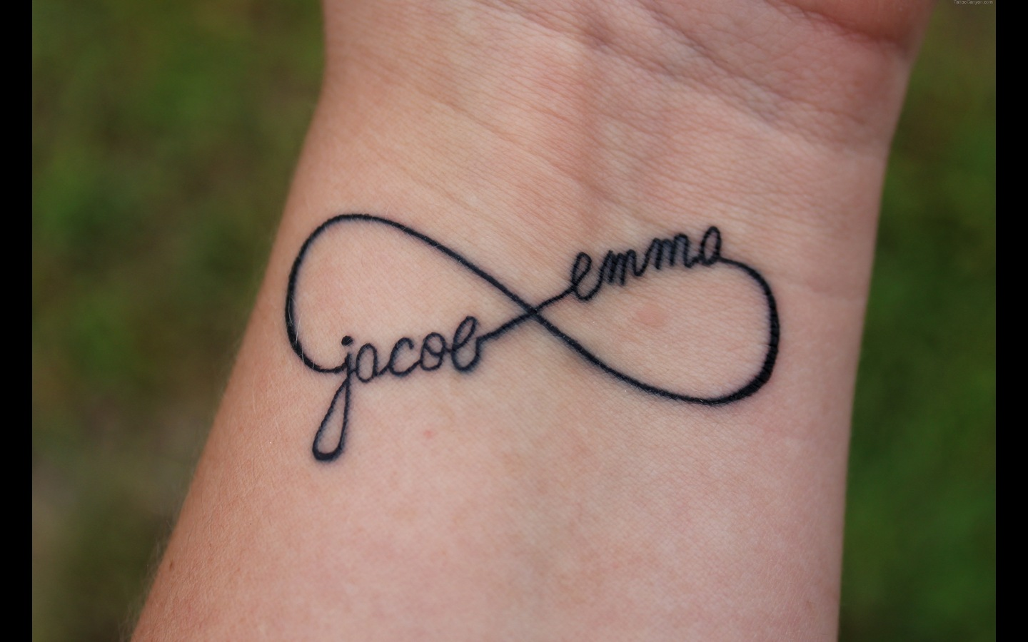 Infinity Symbol With Couple Names Tattoo on Wrist