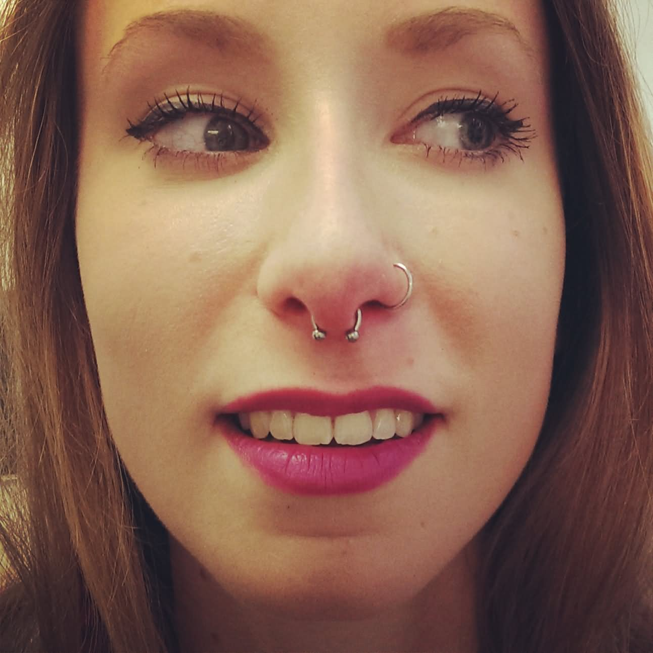 Left Nostril And Septum Piercing Image