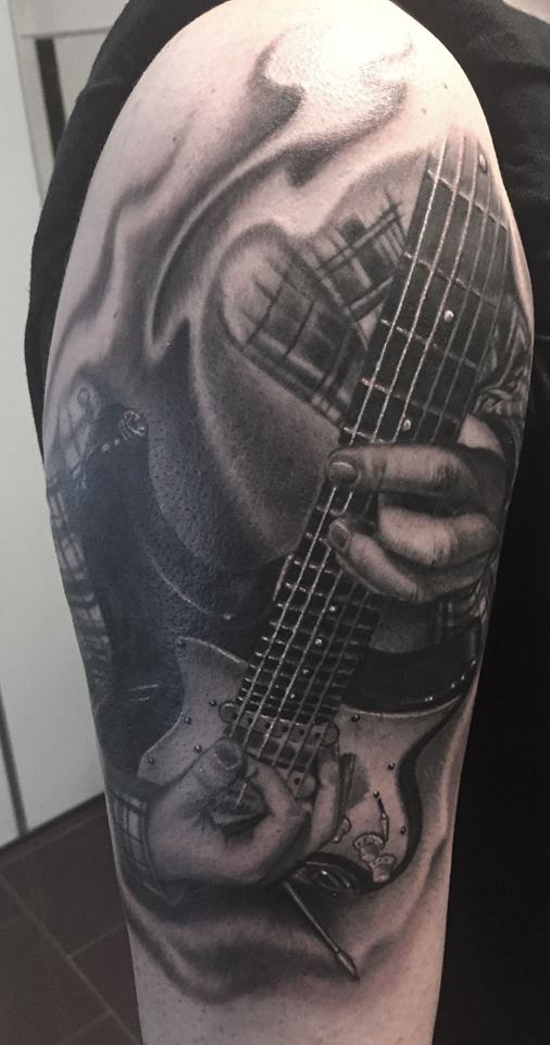 Nice Guitar tattoo on right half sleeve by herm