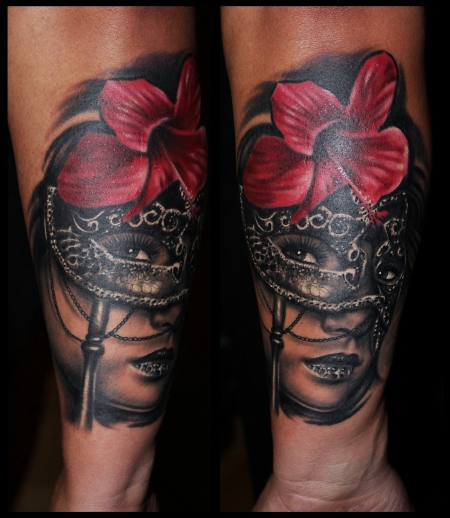 Black Ink Masked Lady With Red Hibiscus Tattoo On Forearm