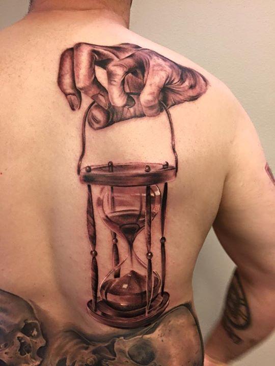 b790545f6 Hand holding hourglass tattoo on back