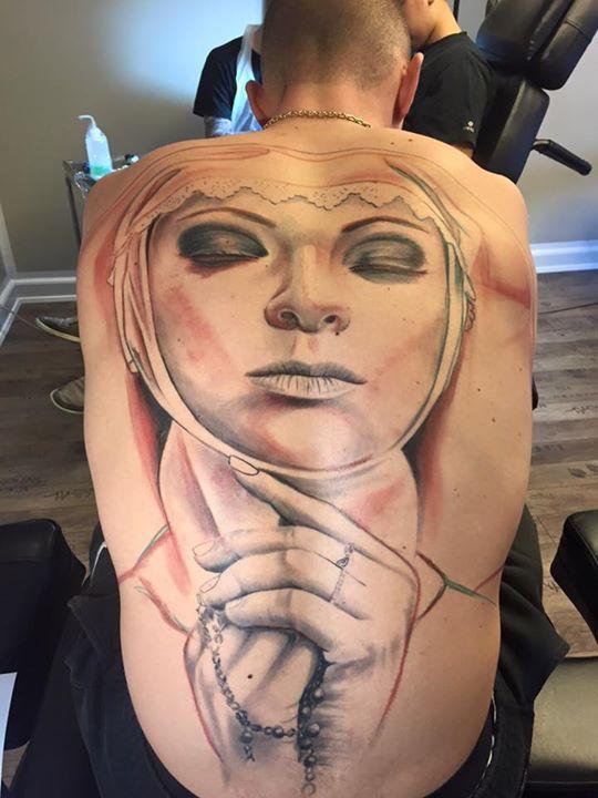 praying nun�s portrait tattoo on full back