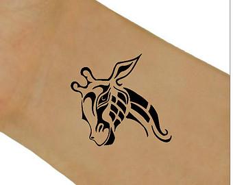 Tribal giraffe tattoo - photo#23