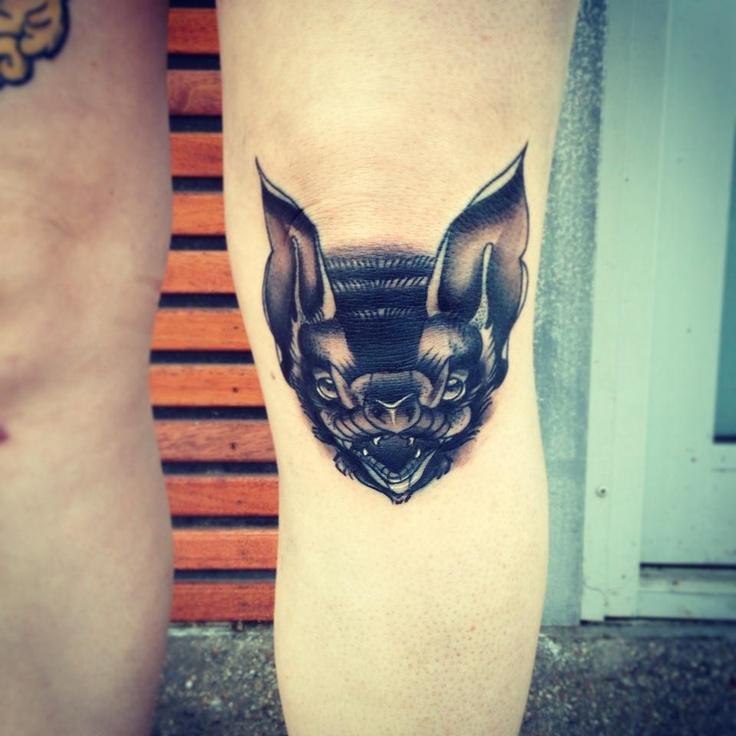 Black bat face tattoo on knee by pari corbitt for Bat sleeve tattoo