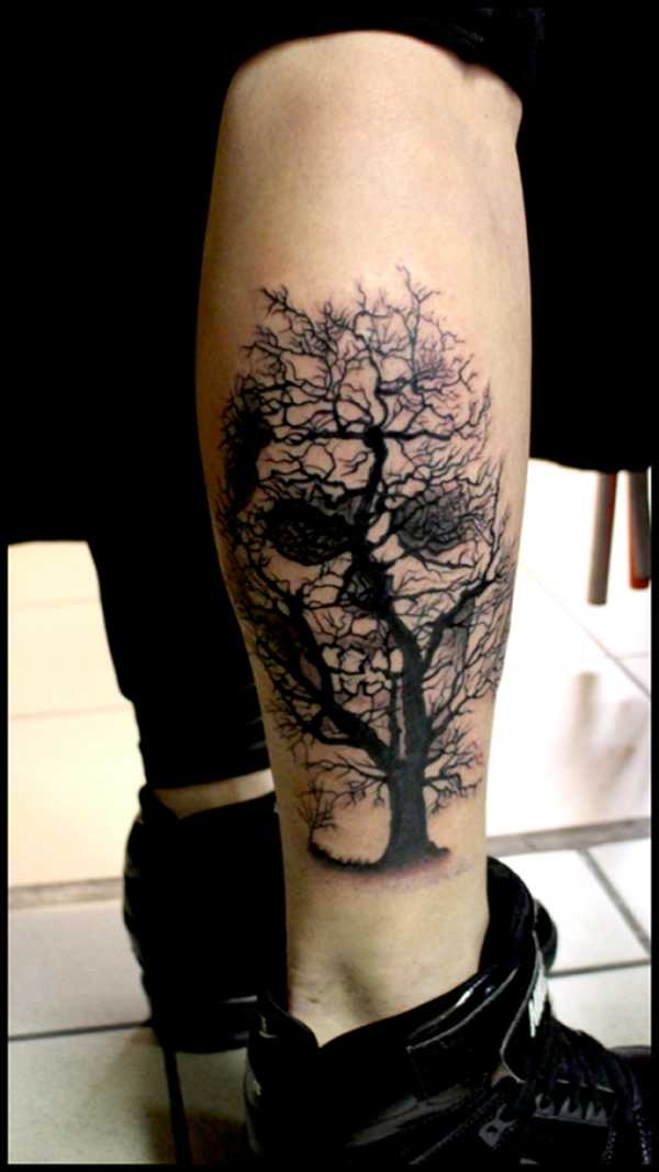 Black scary tree with skull tattoo on leg by raf ethno for Skull leg tattoos