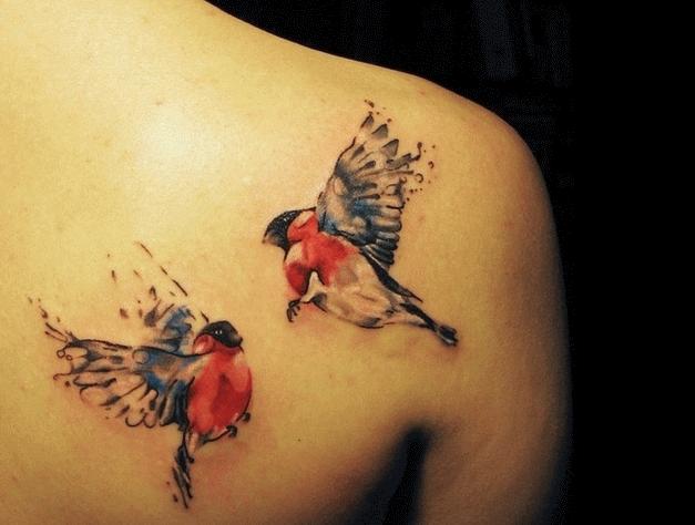 Cute flying birds and cross tattoo on upper back for Birds flying tattoos