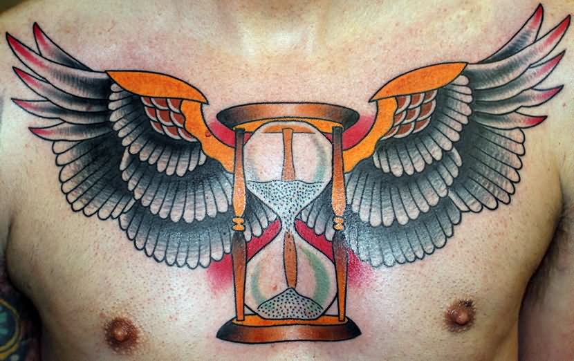Colorful Hourglass With Wings Tattoo On Man Chest