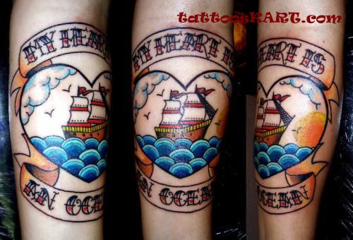 Colorful Ship On Ocean In Heart Tattoo On Arm