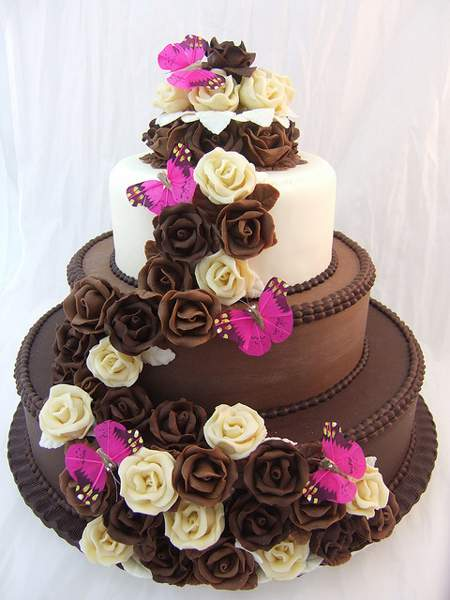 Big Chocolate Cake With Brown And White Rose Flowers