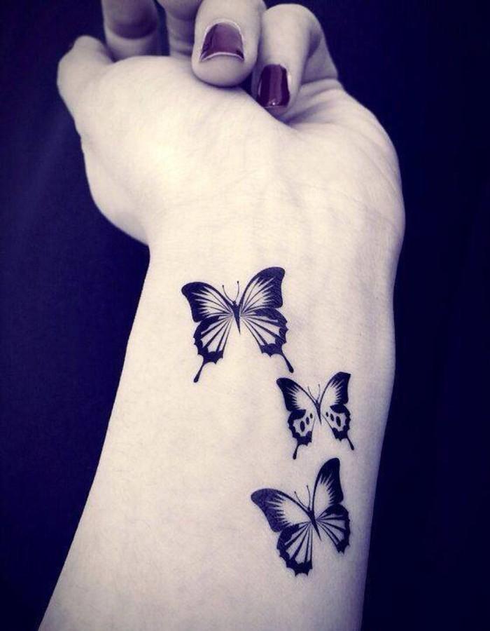 Black Cute Three Little Butterflies Tattoo On Girl Wrist