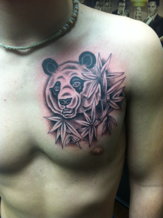 Abstract Panda Tattoo On Forearm