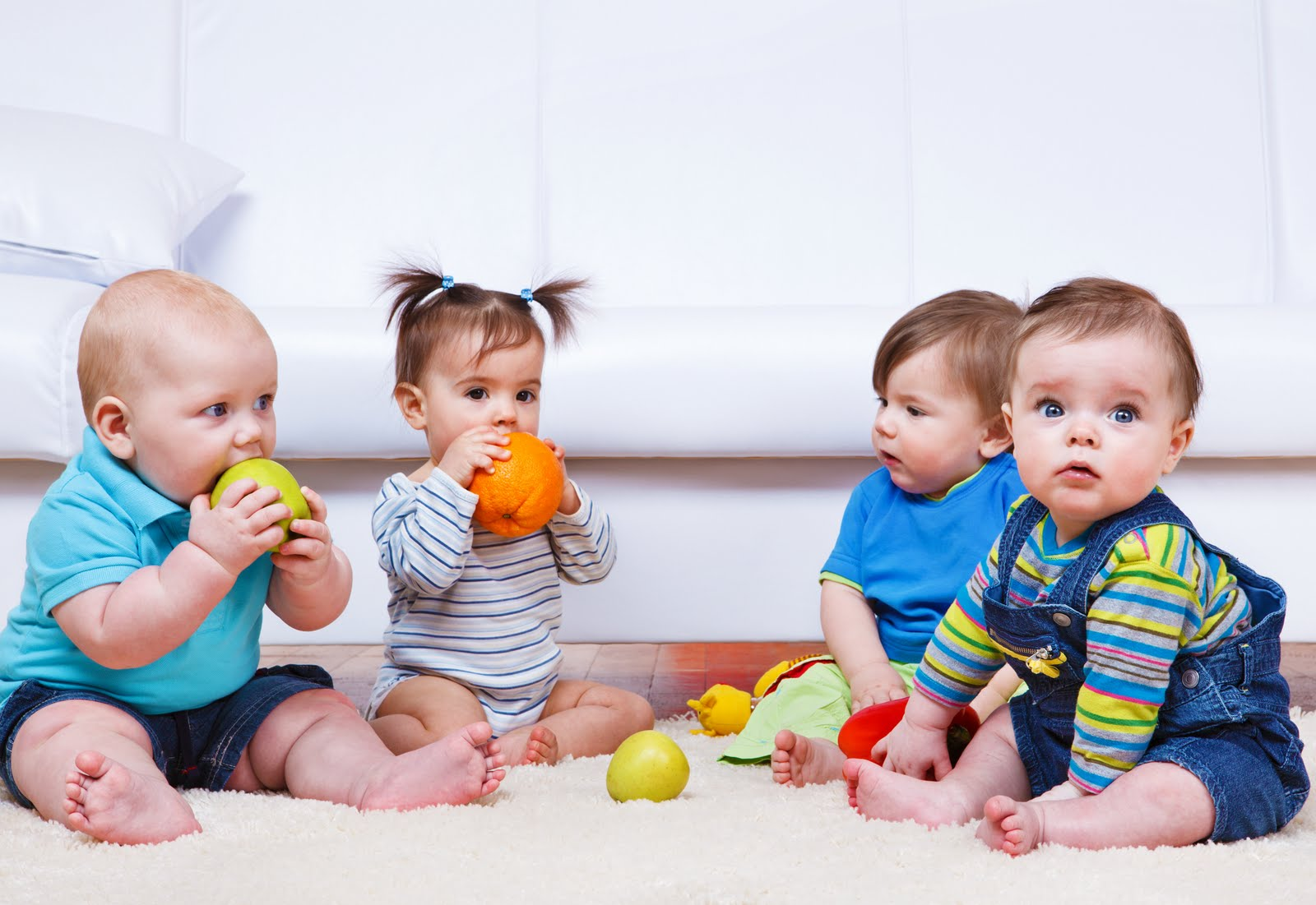 Group Of Babies Playing