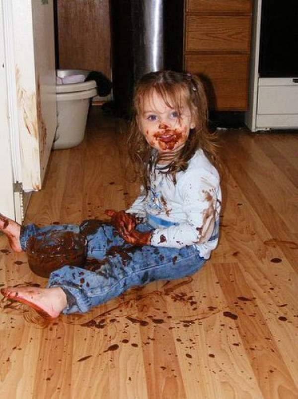 baby girl eating chocolate funny picture