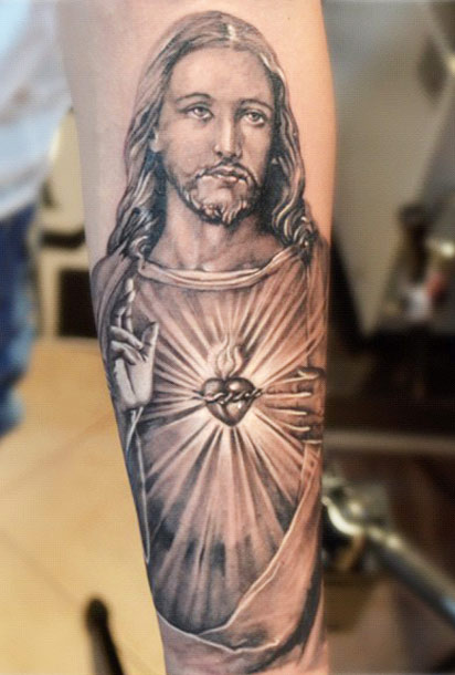 black and grey religious 3d jesus tattoo on forearm