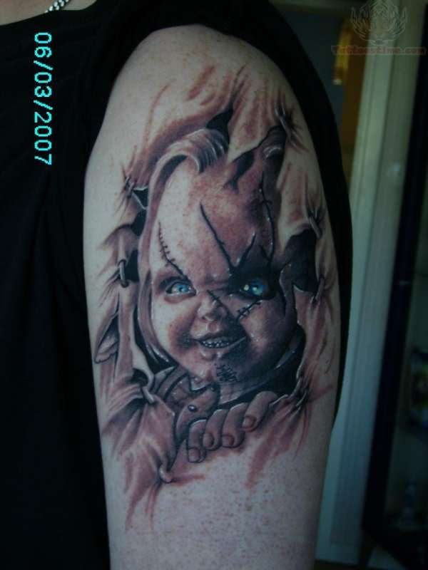 572829d3d Black And Grey Ripped Skin Chucky Face Tattoo On Shoulder
