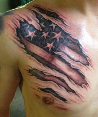 20 incredible flag tattoo images gallery for Ripped skin flag tattoo