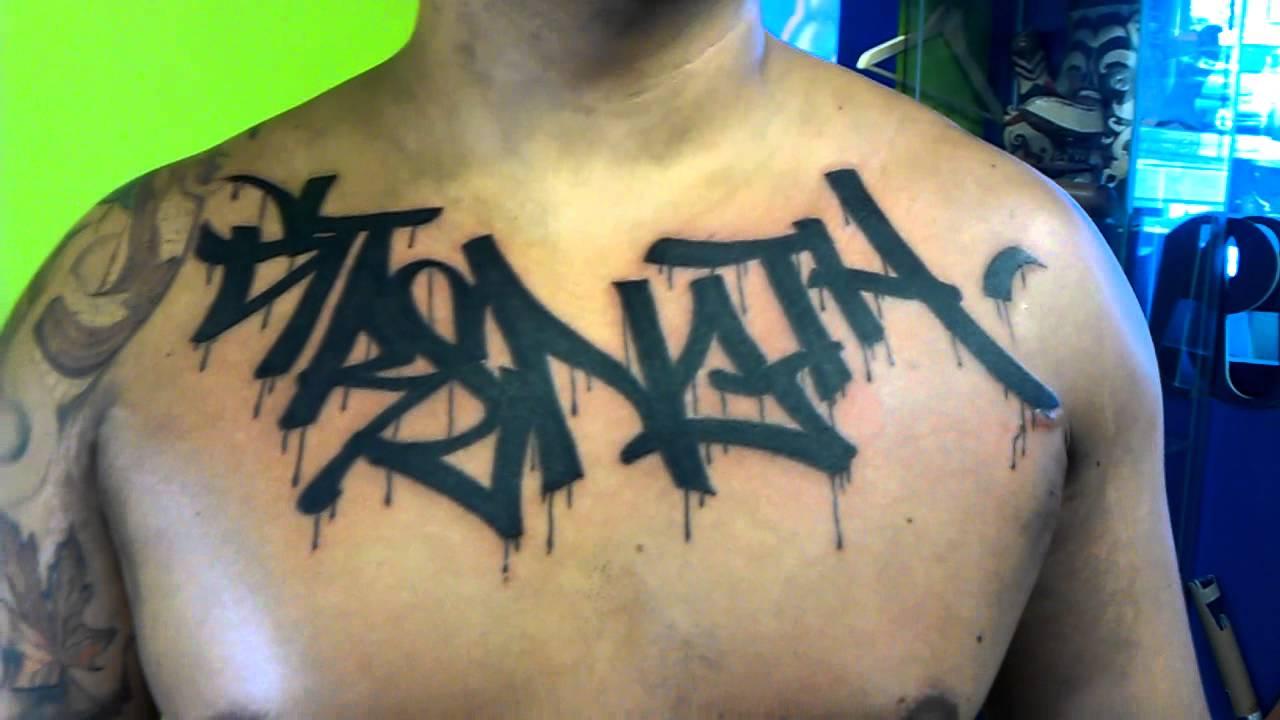 83bcc4c19 Black Ink Graffiti Tattoo On Chest For Men