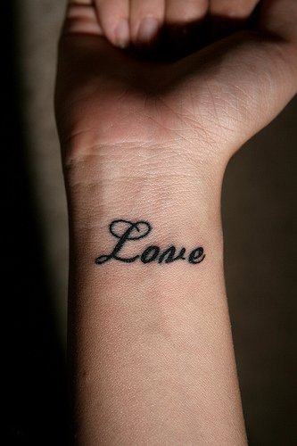 Black Love Tattoo On Right Wrist