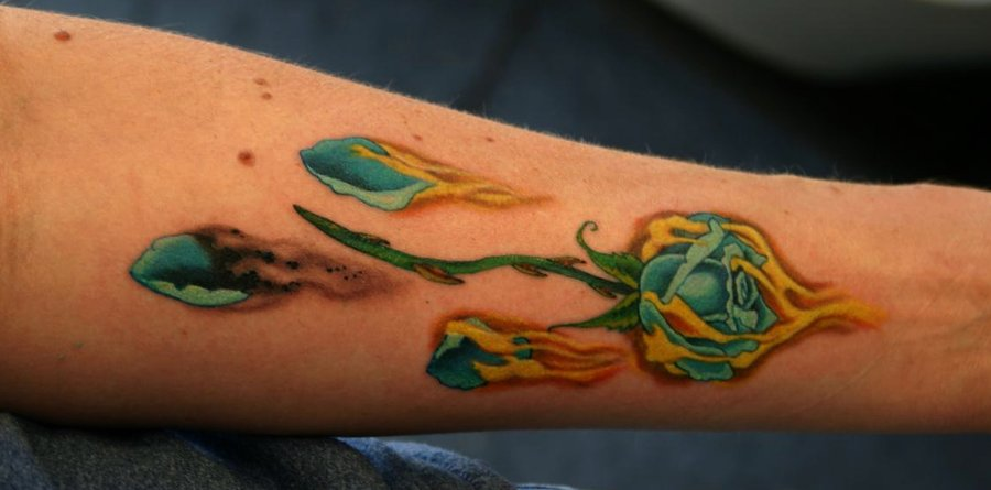 Blue Rose In Fire Flame Tattoo On Forearm By Pam