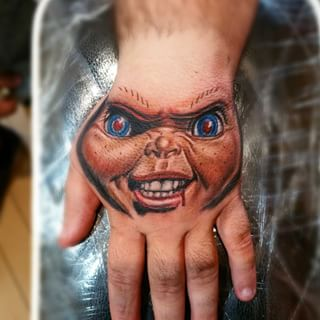chucky face tattoo on hand. Black Bedroom Furniture Sets. Home Design Ideas
