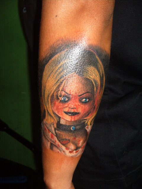 colorful chucky bride tattoo on forearm by jimmy. Black Bedroom Furniture Sets. Home Design Ideas