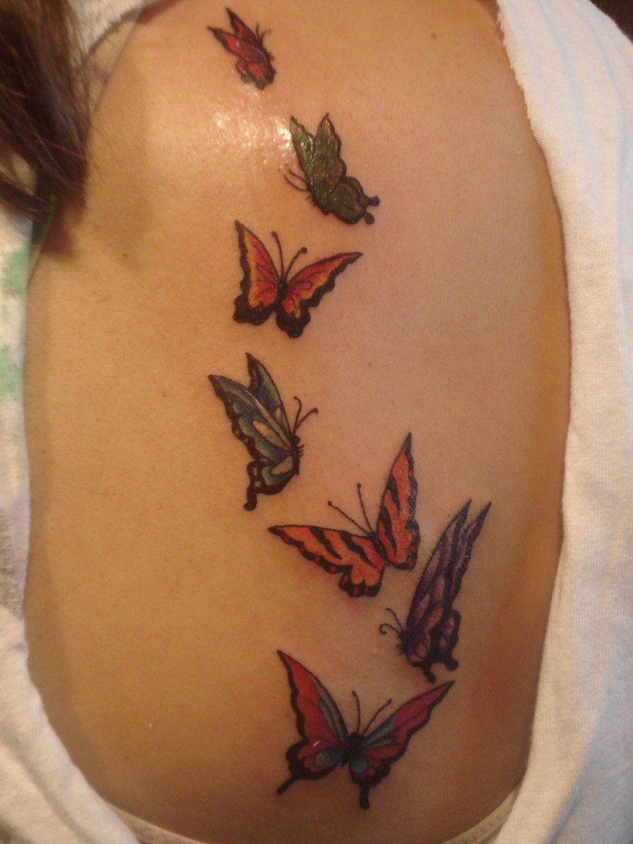 81aa22169 Colorful Flying Butterflies Tattoo on Siderib