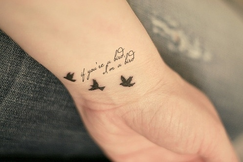 Flying Birds And Love Quote Tattoo On Wrist