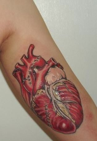human heart with stitches tattoo on bicep. Black Bedroom Furniture Sets. Home Design Ideas