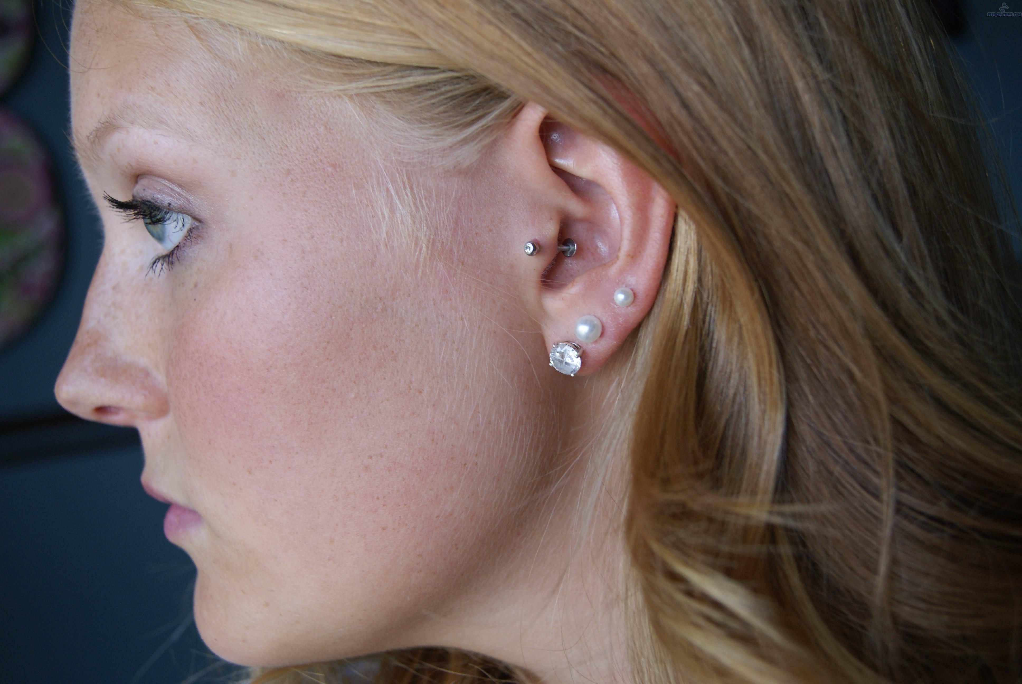 Beautiful Triple Tragus Piercing With Diamond Studs