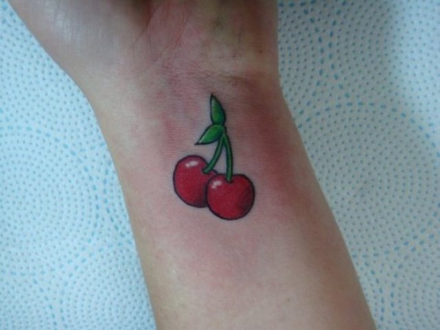 Cherry flaming pussy tattoo