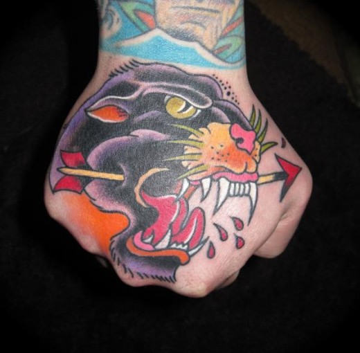 Arrow Ripped In Panther Mouth Tattoo On Hand