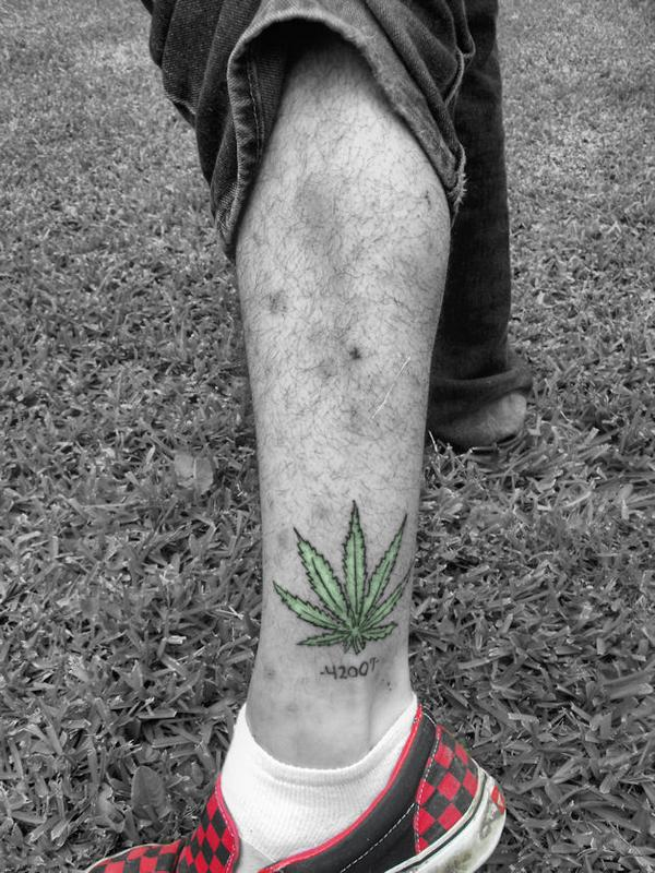 Green weed leaf tattoo on leg by eric garcia for Weed tattoo images