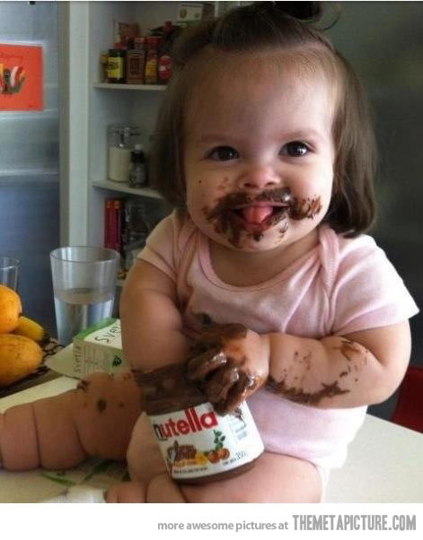 Little Girl Eating Nutella Funny Image