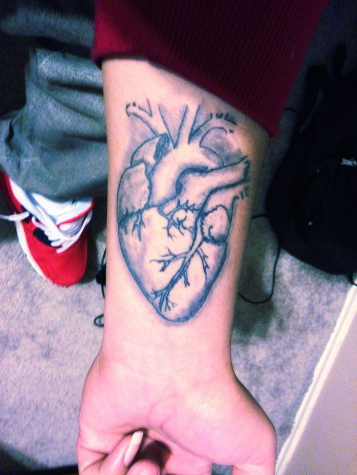 Black And Grey Real Heart Tattoo On Wrist