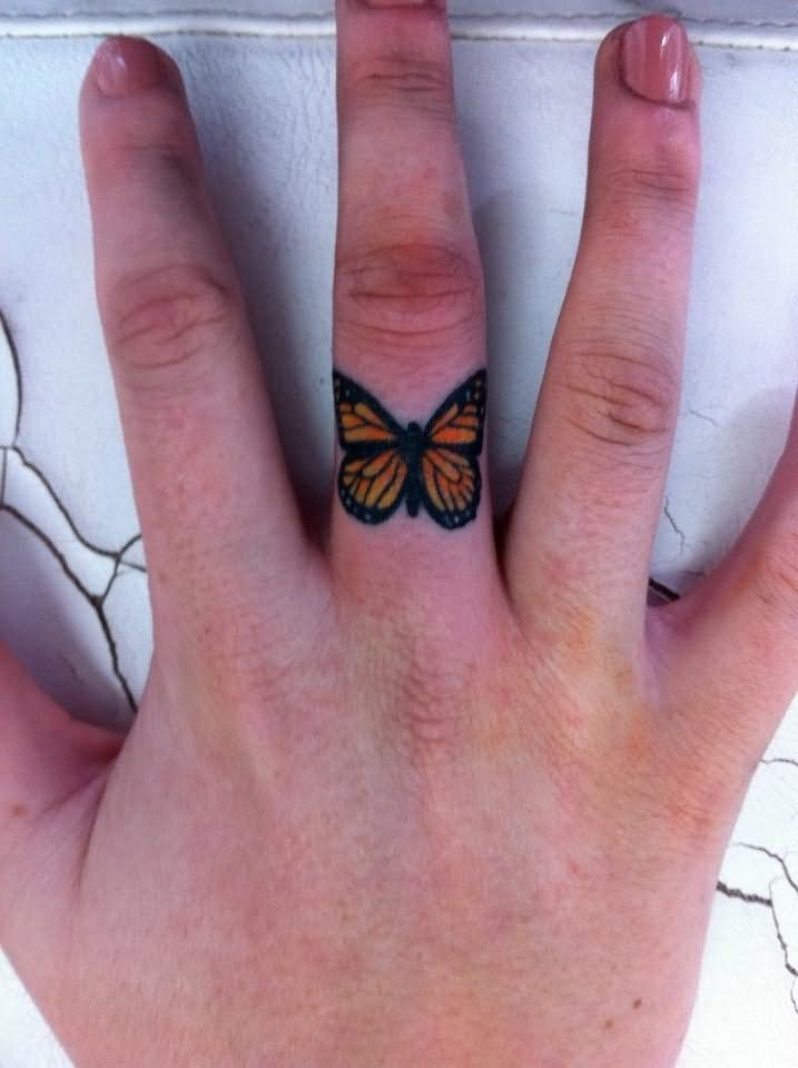 Colorful Butterfly Ring Tattoo On Finger