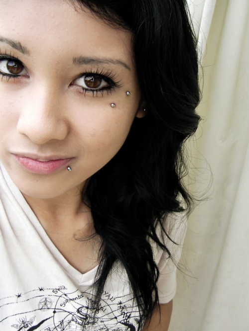 Girl Lower Lip and Surface Anti Eyebrow Piercing
